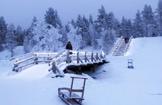 Finland- Kakslauttanen-arctic-resort-frozen-bridge