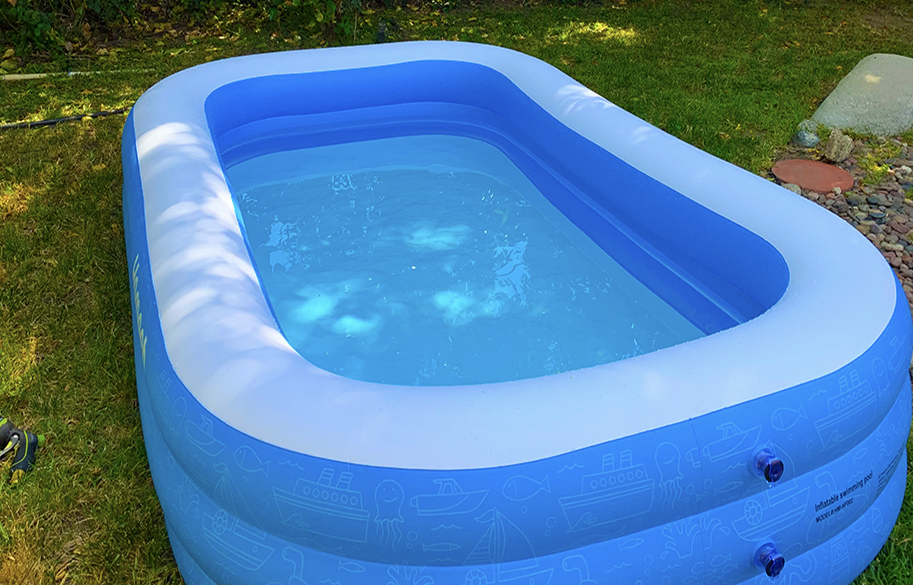 reconnect-with-your-inner-child-quarantine-swim-in-inflatable-pool-water-day-pool-in-back-yard-main-image