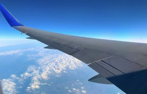 flying-on-a-plane-during-covid-19-photo-looking-at-the-wing-of-a-plane