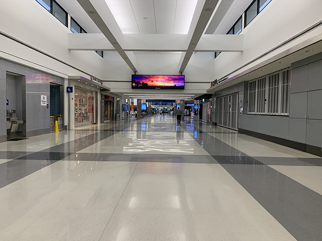 flying-on-a-plane-during-covid-19-united-terminal-at-lax-completely-empty