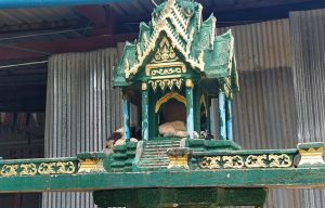 what-is-a-spirit-house-guide-to-spirit-houses-malorie-mackey-malories-adventures-cambodia-cat-sleeping-in-spirit-house