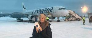 travel-travel-blog-finnair-malories-adventures-malorie-mackey-getting-on-plane